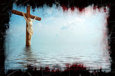 Jesus haloed on a cross standing in the middle of the ocean. Grunge frame and weathering with blood-color trails on adding beautiful drama to the picture. — Stock Photo