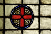 Stained Glass window with an Eastern orthodox square cross in a halo of flames — Stock Photo