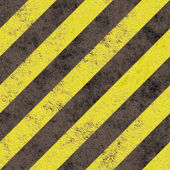 Old grungy yellow hazard stripes on a black asphalt - seamless texture perfect for 3D modeling and rendering — Stock Photo