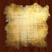 Old weaved parchment on a cherry wood board — Stock Photo