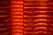 A vibrant orange curtain backlit by the sun. Photo texture — Stockfoto