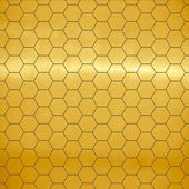 Brushed gold large honeycomb tiles texture with highlight — Stock Photo