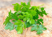 Bunch of fresh green parsley on a wooden background — Stock Photo