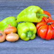 Fresh sweet green peppers with onion and tomatoes (sort Beauty Lottringa) on an old wooden table — Stock Photo #13410074