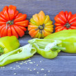 Fresh sweet green peppers and tomatoes (sort Beauty Lottringa) on an old wooden table — Stock Photo