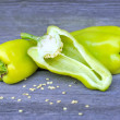 Fresh sweet green peppers on an old wooden table - Stock Photo