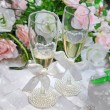 Two wedding glasses of fiancees filled with champagne — Stock Photo