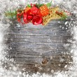 Christmas composition on a snowbound wooden background — Stock Photo