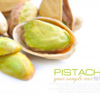 Pistachio nuts on white background — Stock Photo