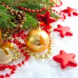 Christmas decorations of bauble are with the branches of fir on snow — Foto Stock