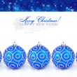 Blue christmas balls with snow on a festive background with space for text — Stock Photo