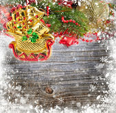 Christmas decoration is a sledges on a snowbound wooden background — Stock Photo