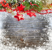 Christmas decorations of bauble are with the branches of fir on a snowbound wooden background — Photo