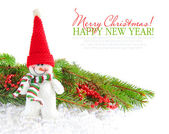 Snowman with the branches of fir and Christmas decorations — Stock Photo