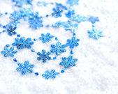 Christmas blue snowflakes of decoration on snow — Stock Photo