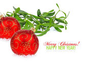 Christmas red balls and branch of mistletoe — Stock Photo