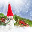 Snowman with the branches of fir and Christmas decorations on a festive background — Stock Photo