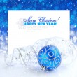 Christmas blue and silver decorations on festive background a postal with sample text — Stock Photo #15762455