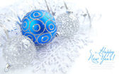 Christmas blue and silver decorations on white with sample text — Stock Photo