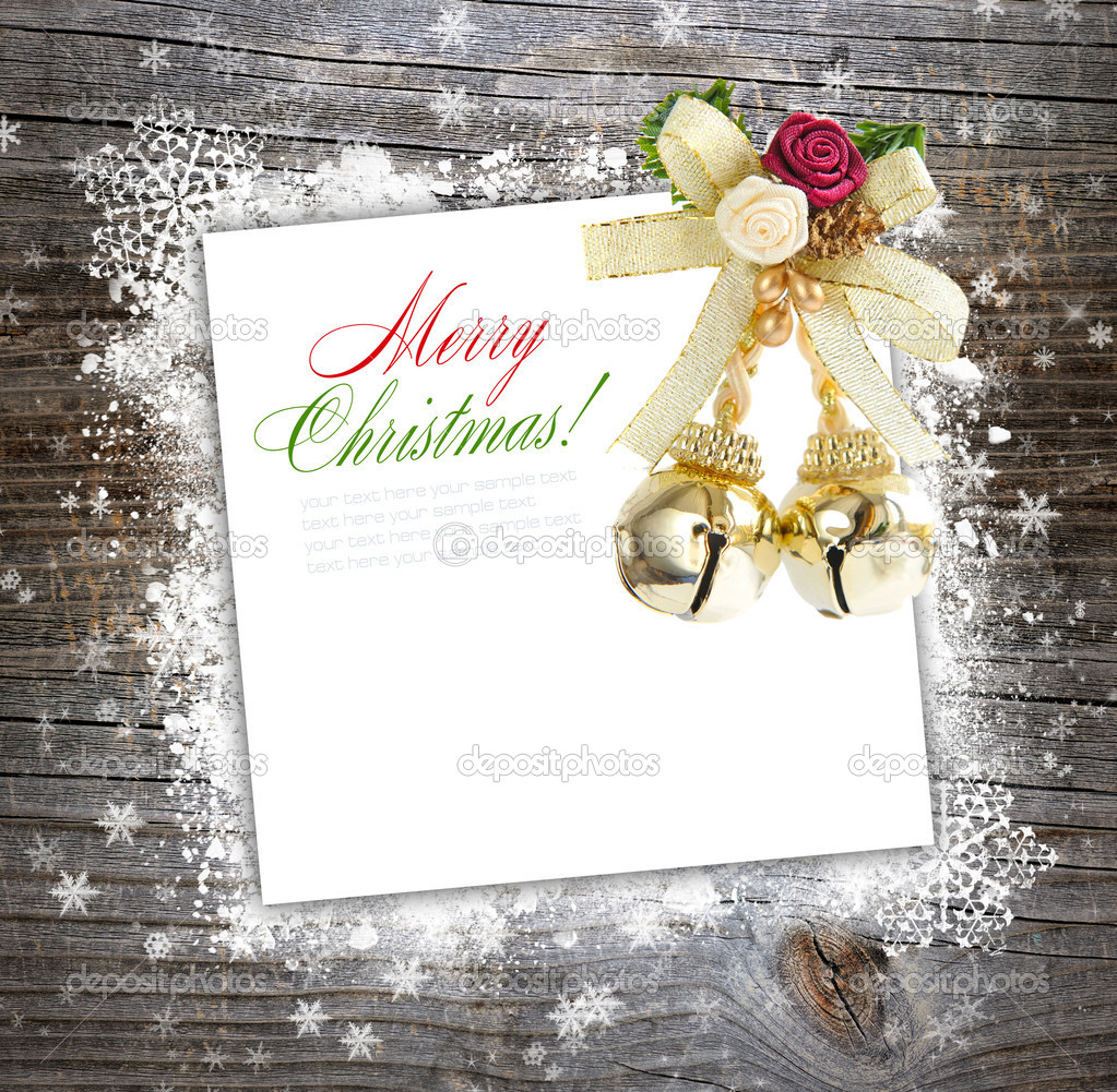 Christmas postal with a decoration on a wooden background with snowflakes — Stock Photo #15762531