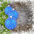 Blue and silver christmas decoration baubles and pine on old wooden background — Stock Photo