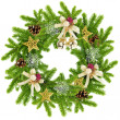 Christmas wreath with the branches of spruce and by decorations on a white background - Stock Photo