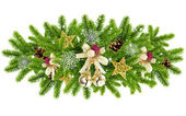 Christmas composition is with the branches of spruce and by decorations on a white background — Stock Photo