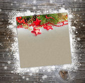 Christmas postal on a wooden background with snowflakes — Stock Photo