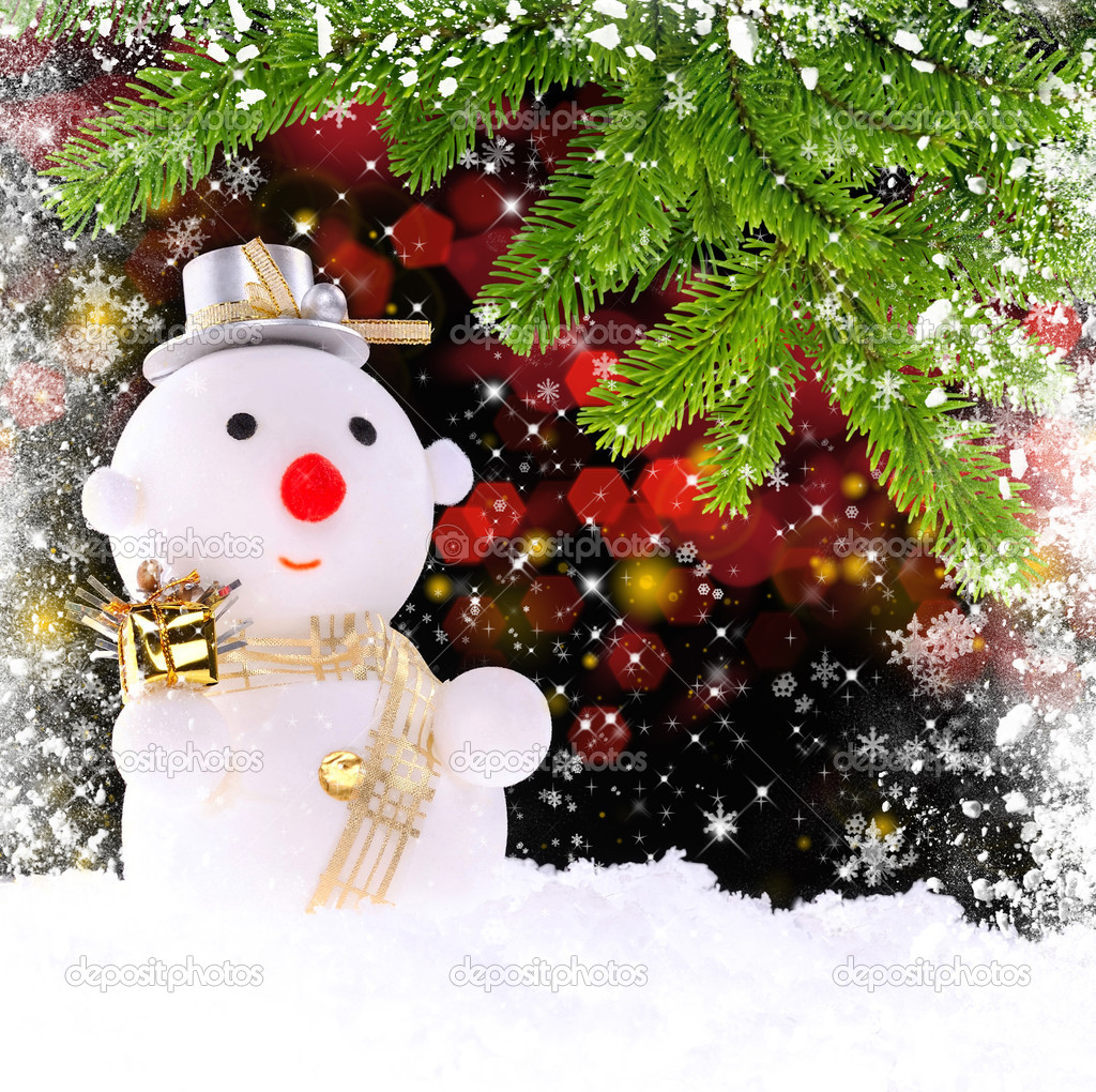 Snow man with by the branches of spruce on a festive background — Stock Photo #15886091