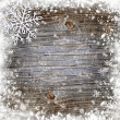 Snowflake on a snowbound old wooden background — Stock Photo #16318369