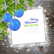 Christmas composition is on the sheet of paper on snowbound wooden background — Stock Photo