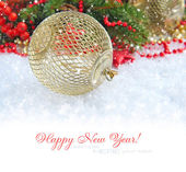 Christmas decoration with the branches of spruce on snow — Stock Photo