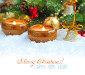 Christmas background is with candles on snow — 图库照片