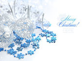 Christmas festive background with silver and blue baubles — Stock Photo