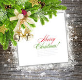 Christmas composition is on the sheet of paper on a winter wooden background — Stock Photo