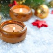 Christmas background is with candles on snow — Stock Photo #16926783