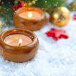Christmas background is with candles on snow — Stock Photo