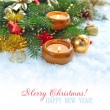 Christmas composition is with candles on snow — Stock Photo
