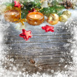 Christmas composition is with candles on a snowbound wooden background — Stock Photo