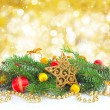 Branches of spruce are with christmas decorations on gold background — Stock Photo