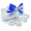 A little gift is with christmas beads on a white background — Stock Photo