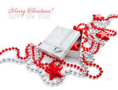 A little gift is with christmas beads and by stars on a white background — Stock Photo