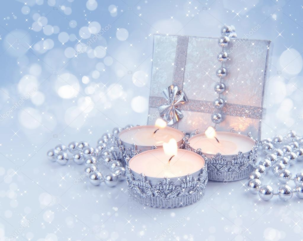 Christmas candles are with baubles on a festive background  Stock Photo #16926847