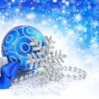 Christmas blue ball is with baubles on festive background - Stock Photo