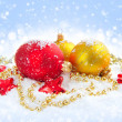 Christmas decorations of bauble on snow — Stock Photo