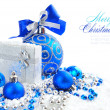 Christmas blue and silver decorations on snow — Stock Photo #17377863