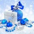 Christmas blue and silver decorations on snow — Stock Photo #17377867