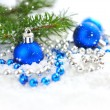 Christmas blue and silver decorations on snow — Stockfoto