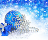Christmas blue ball is with baubles on festive background — Stock Photo