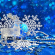 Christmas decorations and deer are on a blue festive background — Stock Photo